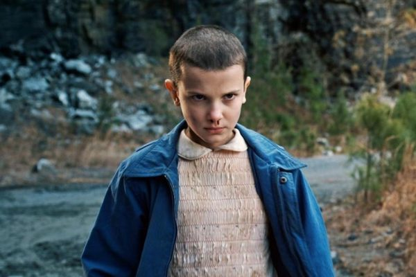 Above: Millie Bobby Brown is Eleven in 'Stranger Things'