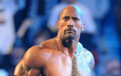 "Above: Dwayne ""The Rock"" Johnson poses in the wrestling ring"