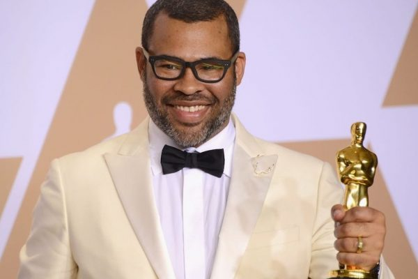 "Above: Jordan Peele holding his Academy Award for ""Best Original Screenplay"""