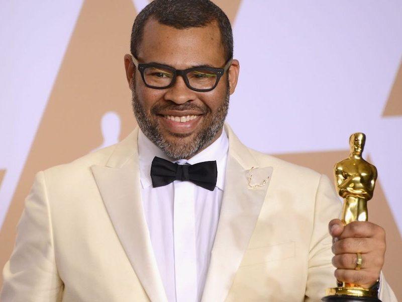 "Above: Jordan Peele holding his Academy Award for ""Best Original Screenplay"""