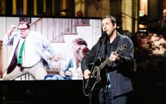 Above: Adam Sandler closes out 'SNL' with a sweet guitar number